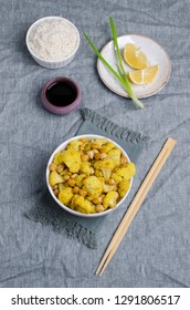 Roasted cauliflower with chickpeas and white rice on textile background. Selective focus.