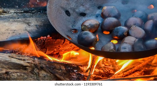 roasted chestnut - specialty ardéchoise - specialty of Ardèche in France - chestnut on the flame of a fire of wood