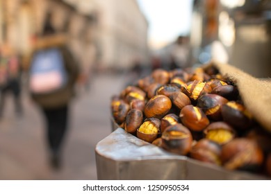 Roasted chestnuts for sale on the street in the city in the fall.