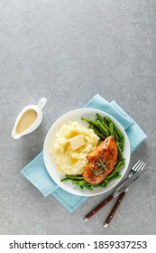 Roasted chicken breast with green beans and boiled mashed potatoes. Dinner or breakfast serving.