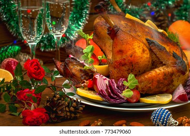 Roasted chicken. Christmas Dinner. Winter Holiday table served. Wooden background. Close-up. Top view