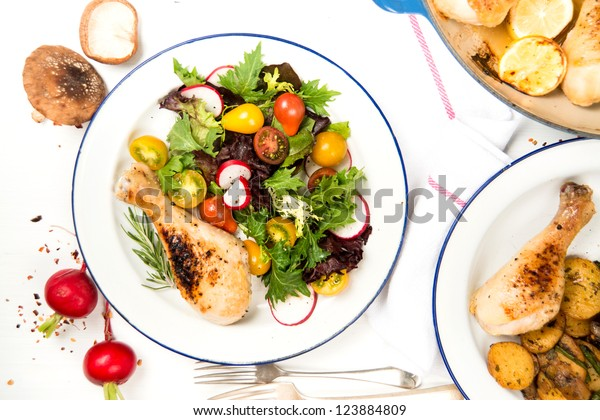 Roasted Chicken Drumstick Served with Fresh Greens and Tomato Salad