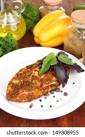 Roasted chicken fillets on white plate and vegetables, on wooden background