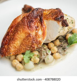 Roasted Chicken. Garbanzo beans, roasted onions and wild mushrooms