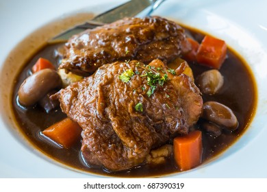 Roasted chicken with ham,carrot and mushroom in red wine sauce served with mashed potato