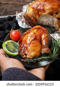 Roasted chicken leg with hand