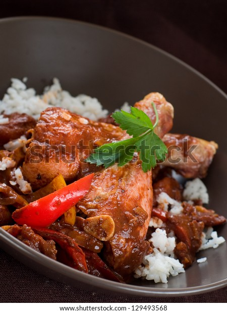 Roasted chicken legs with baked vegetables and rice, selective focus