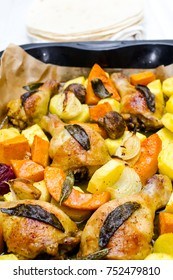 Roasted chicken legs with vegetables, herbs and pumpkin