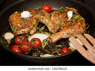 Roasted chicken legs with white cheese and tomatoes
