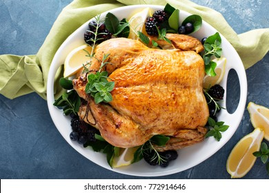 Roasted chicken with lemon and herbs for holiday or sunday dinner