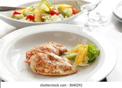 Roasted chicken medallions with vegetable and fruit salad