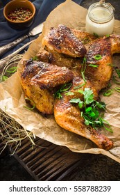 Roasted chicken on chopping board. Style rustic. Selective focus.