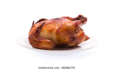 Roasted chicken on plate isolated on white background
