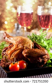 Roasted chicken on table with wine