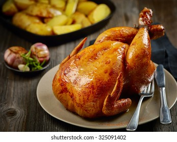 roasted chicken on wooden table