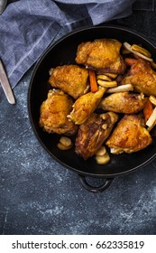 Roasted chicken portion in skillet pan iron