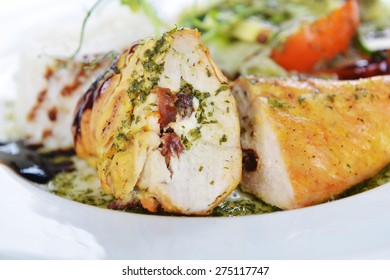 roasted chicken,  rice  and vegetables on dish
