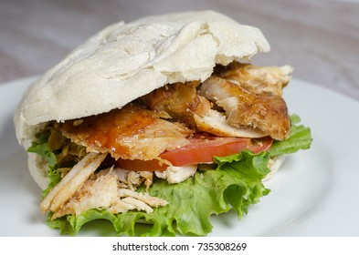 roasted chicken sandwich with tomato and lettuce