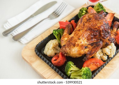 Roasted chicken with vegetables. Thanksgiving or christmas theme.