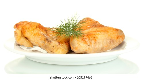 roasted chicken wings with dill in the plate isolated on white