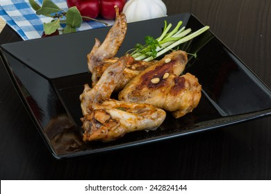 Roasted chicken wings with spices in the bowl