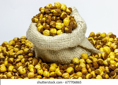 Roasted chickpeas (Chana) spilled out from jute sack