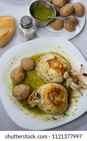 Roasted chocos with green mojo and potatoes in a restaurant in Tenerife, Canary Islands