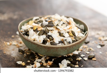 Roasted Coconut Flakes and Pumpkin Seeds for Healthy Snack