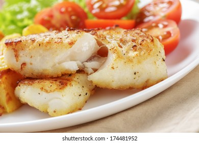 roasted codfish fillet with vegetables, selective focus