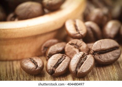 Roasted coffee bean in wooden surface