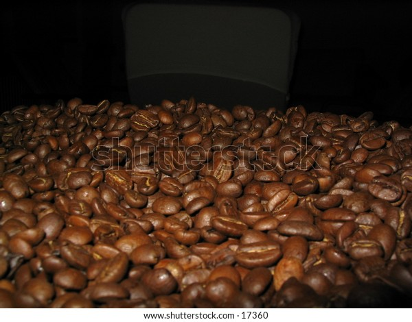 Roasted coffee beans against a black background