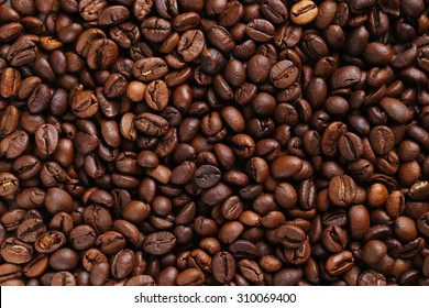 Roasted coffee beans background, close up