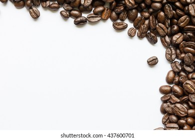 Roasted Coffee Beans background texture isolated on white background frame with copy space for text, macro. Fragrant fried coffee beans