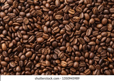 Roasted coffee beans background. Top view. Copy space