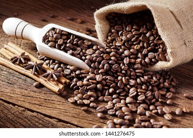 Roasted coffee beans in bag and coffee beans around