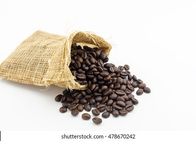 Roasted coffee beans in burlap bag on white background