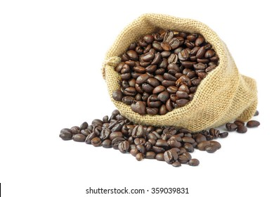 Roasted coffee beans in burlap sack on white background.