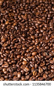 Roasted coffee beans, can be used as a background. with copyspace for your text. Selective focus