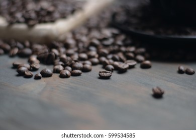 Roasted coffee beans close up on wooden background