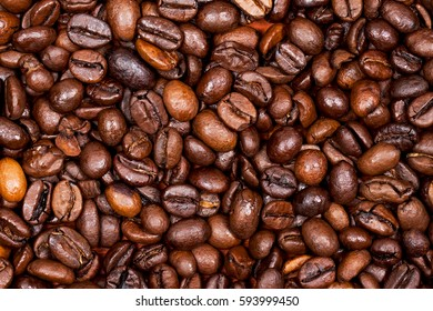 Roasted coffee beans close-up. Aromatic background