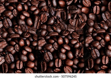 Roasted Coffee beans closeup background.