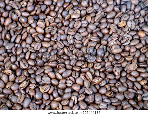 Roasted coffee beans closeup, may be used as background