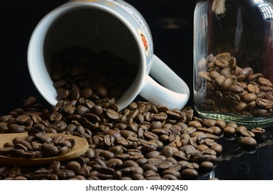Roasted coffee beans in cup.