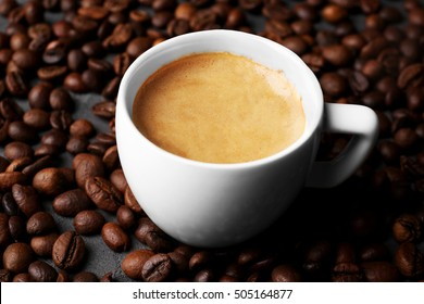 Roasted coffee beans with cup