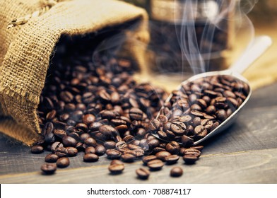 Roasted coffee beans with evaporated smoke dark food.