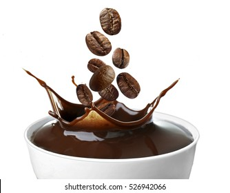 Roasted coffee beans falling into cup, white background