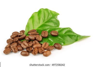 roasted coffee beans and green leaves isolated