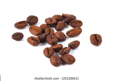 Roasted coffee beans isolated on white background. Three coffee beans..