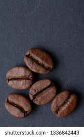 Roasted coffee beans on a dark background, can be used as background