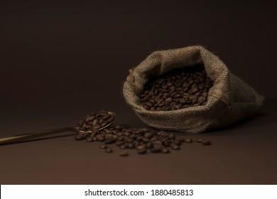 Roasted coffee beans on dark dramatic setup